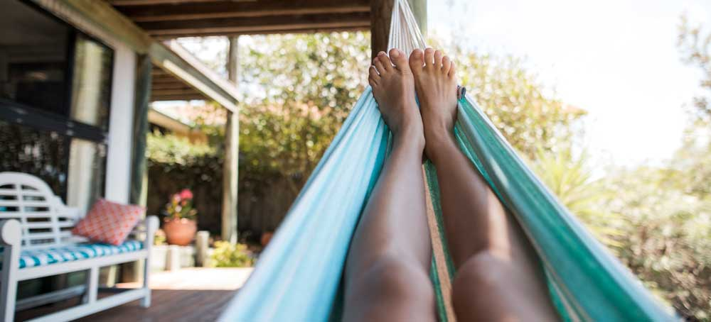 Relaxing on a hammock in summer
